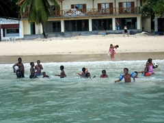 Seychellois children playing in the water. They chased our SCUBA boat goodbye as we were taking off for our first dive of the day