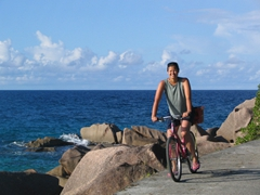 Renting a bike to pedal around La Digue is the best way to travel