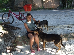 Playing with a couple of La Digue dogs