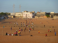 Senegalese youths playing soccer; Dakar