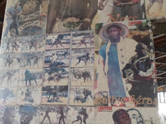 "A ""Lutte"" wrestling poster on the wall inside the fish market section of Dakar's Marche Kermel"