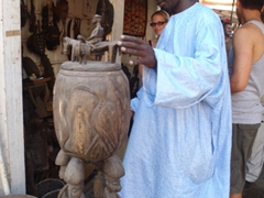 A friendly local showing us some of his amazing wooden carvings; Dakar Marche Kermel