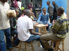 Local guys enjoying a game of cards in the central market; Musanze