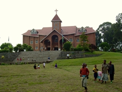 This massive church in the center of Musanze caught our eye. The children swarmed us as soon as they caught sight of us