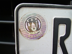 Close up of a Rwanda hologram sticker found on all Rwandan registered vehicle license plates