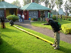 Robby checking out the required distance to keep from the gorillas; reception center at Volcanoes National Park