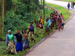 "Village women happy to see a big truck full of ""mzungus"" (white people) driving by"