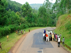 Community effort to push a disabled truck on the road; outskirts of Kigali