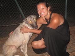 "Becky cuddles up next to the ""guard"" dog; Abuja Sheraton"