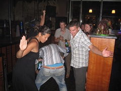 Becky and Dowelly prepare to give Matt an ass slap; Elephant Bar in Abuja Sheraton