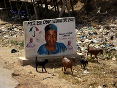 A signpost imploring Dr. Yusuf Agabi to be this district's senator (we saw countless similar billboards and painted walls in election crazy Nigeria)