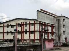 "Our Calabar lodgings, the decrepit looking ""Paradise City"" which looks ancient but was built in 1988"