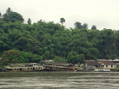 Derelict boats lined the waterfront; Calabar