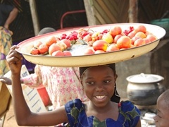Girl selling tomatoes and peppers; Ketou