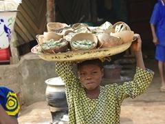 Ketou girl selling ground corn