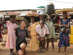 Becky poses with child vendors; Ketou