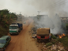 Pollution is a problem in Nigeria. Here, trash is burned on the side of the road; Abeokuta