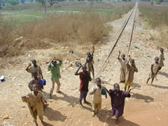 Children greet us by the railroad tracks; Ogbomosho