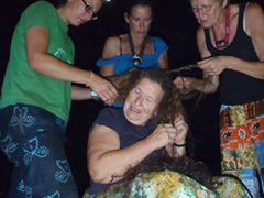 Sara, Bree and Pam assist Norma in taking out her braids; Abuja Sheraton campsite