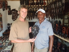 Robby poses next to an African mask that caught his eye; Abuja Craft Village