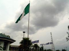 A massive Nigerian flag near the stadium; Calabar