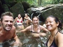 Group photo of us soaking in the waterfall pool; Afi Mountain Drill Ranch