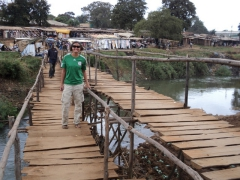 Becky smiles as she crosses a rickety bridge in Lilongwe