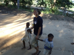 Despite Becky's phobia of children, they clung to her like super glue and walked her through their village