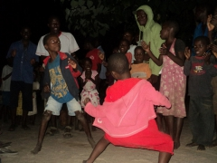 Kande Beach kids put on a show dancing for us during our village meal
