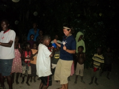 Becky busts a move dancing with a village boy; Kande Beach