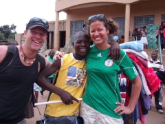 Lucky and Becky pose with a friendly vendor (proudly wearing an Obama T-shirt); Lilongwe
