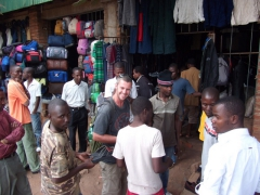 An ironic moment: Robby surrounded by shoe sellers. He eventually declined buying a replacement pair (mere minutes before his flip flops died); Lilongwe
