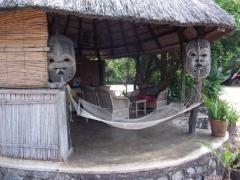 An inviting hammock beckons; Kande Beach