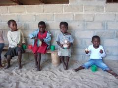 School children eating their mid morning snack; Mphatso Children's Foundation kindergarten