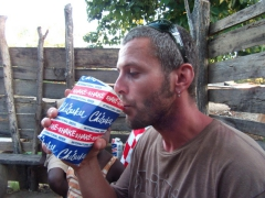 Robby drinking some serious cheap millet beer (its in a cardboard box and only cost about 25 cents!)
