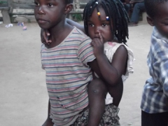 Young Malawians mesmerized at seeing us at the local bush bar