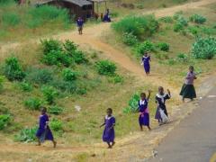 School girls waving hello