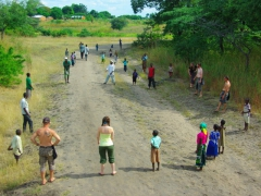 One of our truck lunch stops (the curious villagers loved playing with Lucky's rugby ball)