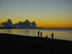 Silhouettes by Lake Malawi before sunrise