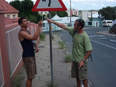 Luke and Robby mimic a weird yield sign in Windhoek