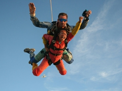 Becky assumes the superman pose; Swakopmund skydiving