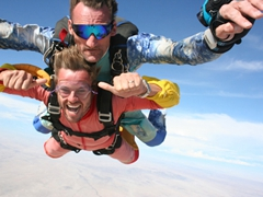 Robby is in good hands with Mathias and loving his first sky dive; Swakopmund