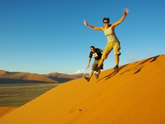Becky and Dowelly jumping from Dune 45; Sossusvlei
