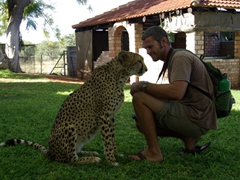 Despite his cat allergies, Robby gets up close and personal with a cheetah; Camp Otjitotongwe