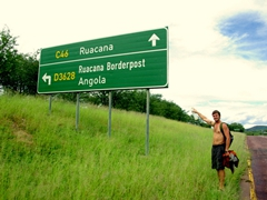 Robby points to a Ruacana Falls/Angolan Border signpost