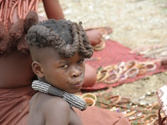 A Himba girl checks us out; Ohungumure Village