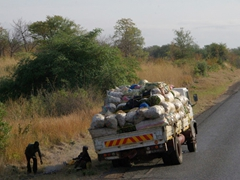 Tire problems are a common sight on overloaded vehicles plying Mozambique's roads