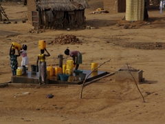 Villagers drawing water from the main well