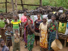 Friendly locals laugh as we bid them farewell after purchasing 10 bags of charcoal ($2 a bag!)
