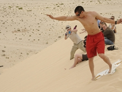 Luke attempting to sand board his way down a dune; western Sahara